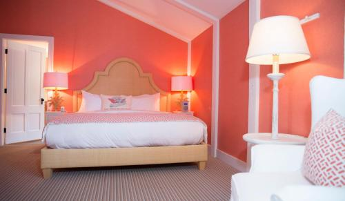 A bed or beds in a room at The Tides Beach Club