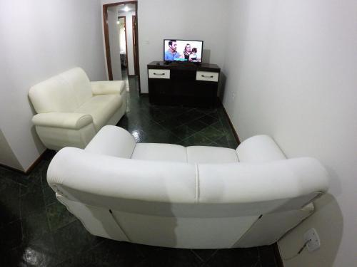 A seating area at Praia Linda Hospedagem