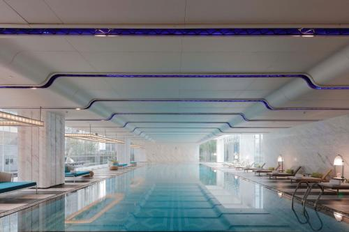 The swimming pool at or near Conrad Guangzhou
