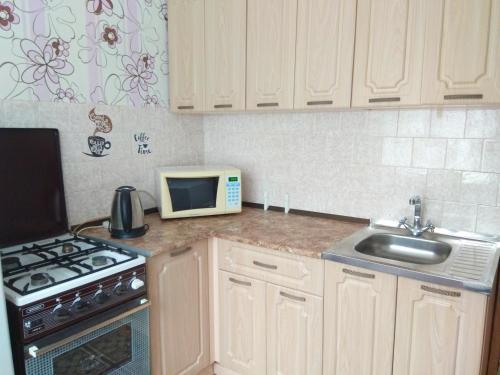Кухня или мини-кухня в Аппартаменты у Алатыря