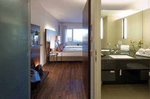 Ein Badezimmer in der Unterkunft Hotel Penz West