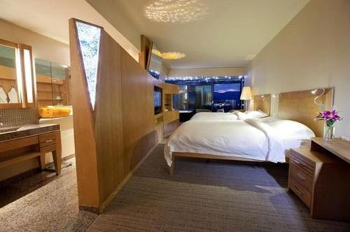 A bed or beds in a room at Sparkling Hill Resort and Spa - Adults-Only Resort