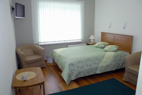 Кровать или кровати в номере Гостевой Дом Аравана