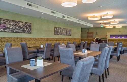 Ein Restaurant oder anderes Speiselokal in der Unterkunft Arthur's Hotel am Achensee