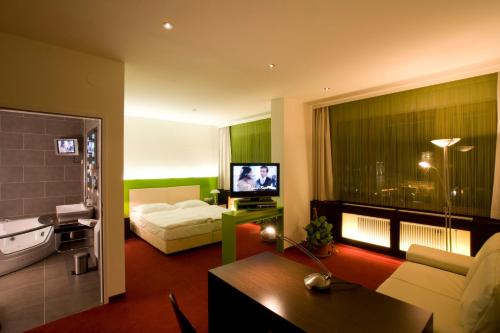A television and/or entertainment center at Hotel Restaurant Pusswald