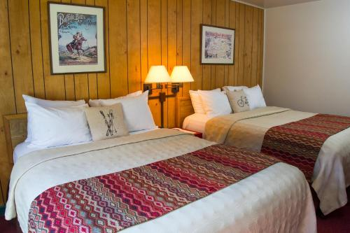 A bed or beds in a room at Targhee Lodge by Grand Targhee Resort