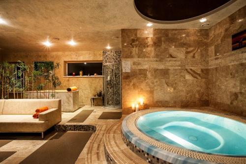 The swimming pool at or near Ararat All Suites Hotel Klaipeda