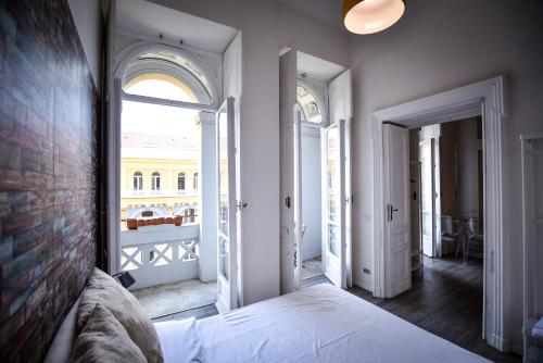 A bed or beds in a room at Astor Vintage Apartaments