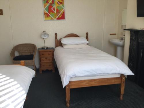 A bed or beds in a room at Bay Lodge