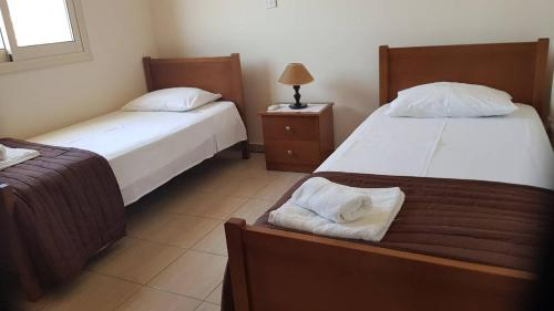 A bed or beds in a room at Lazaros Pissouri Apartments