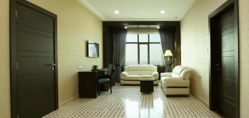 A seating area at Park Regis Lotus Hotel