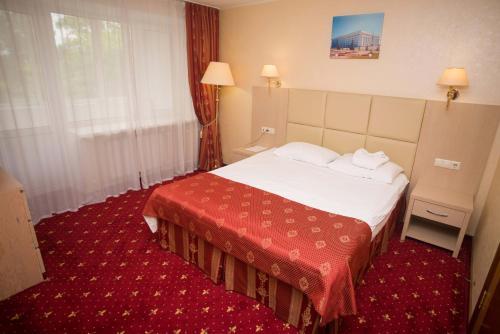 Кровать или кровати в номере AMAKS City-Hotel