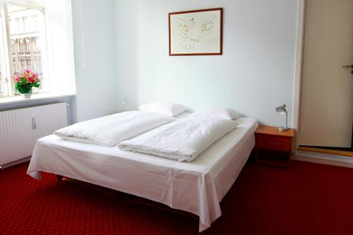 A bed or beds in a room at Hotel Nora Copenhagen