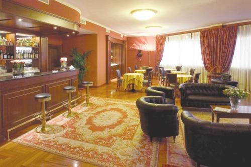 The lounge or bar area at Hotel Maxim