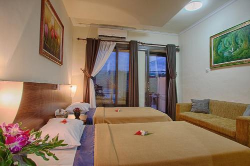 A bed or beds in a room at Matahari Tulamben Resort, Dive & SPA