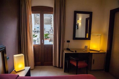 TV o dispositivi per l'intrattenimento presso Hotel Il Portico