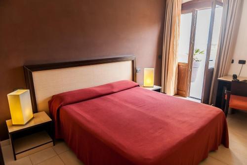 Letto o letti in una camera di Hotel Il Portico