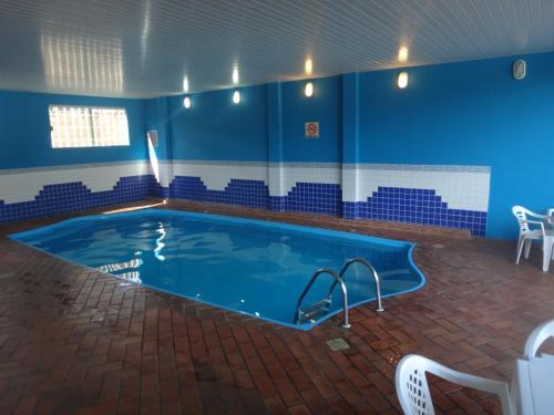 The swimming pool at or near Dom Pedro I Palace Hotel