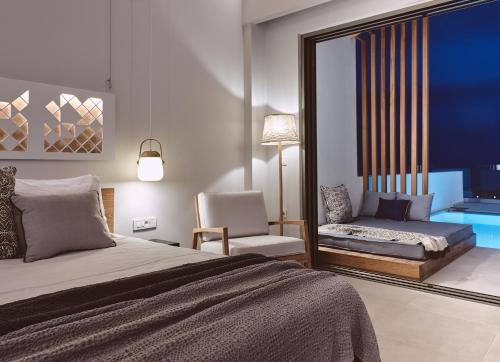 A bed or beds in a room at Hotel St.John Suites Adults Only