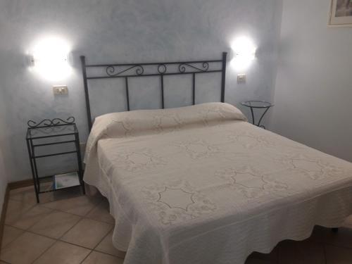 Кровать или кровати в номере Cecco di Nara