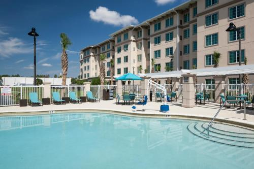 The swimming pool at or close to Residence Inn by Marriott Near Universal Orlando