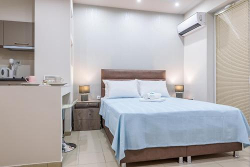 A bed or beds in a room at Greekprom Apartments
