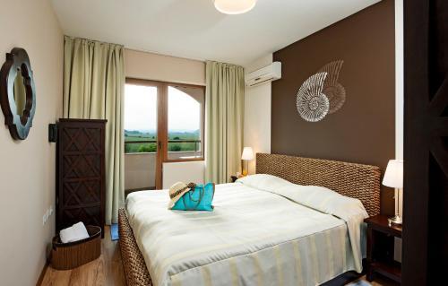 En eller flere senge i et værelse på Sunrise All Suites Resort- All Inclusive