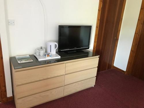 A television and/or entertainment centre at The Barn Lodge