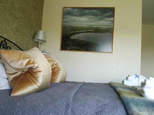 Un ou plusieurs lits dans un hébergement de l'établissement Hillside Lodge B&B