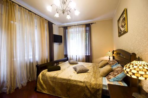 Кровать или кровати в номере Lakshmi Bronnaya