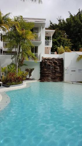 The swimming pool at or near Alassio Palm Cove