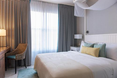 A bed or beds in a room at Melody Hotel - an Atlas Boutique Hotel