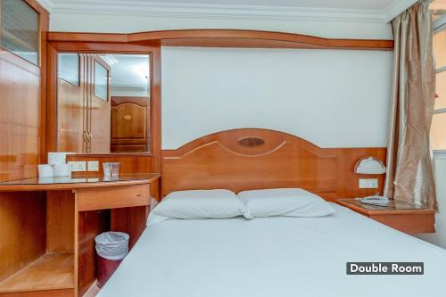 A bed or beds in a room at Diamond Hotel
