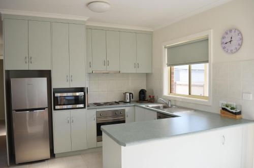 A kitchen or kitchenette at Horsham Central Stay