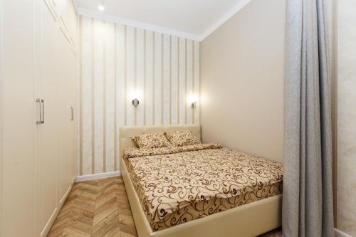 """Кровать или кровати в номере АК """"Столичный"""""""