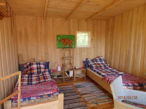 Voodi või voodid majutusasutuse Karu Treehouse toas