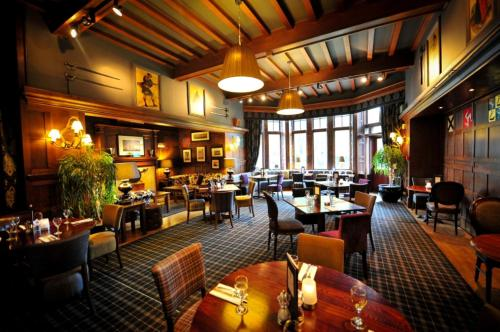 A restaurant or other place to eat at Savoy Park Hotel