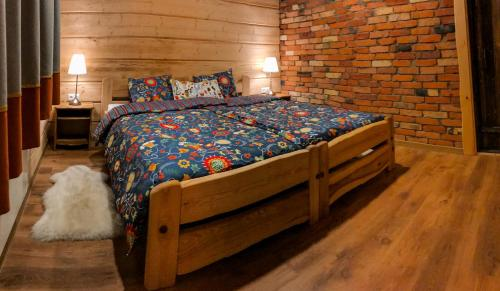 A bed or beds in a room at Kalniaus-Sodyba