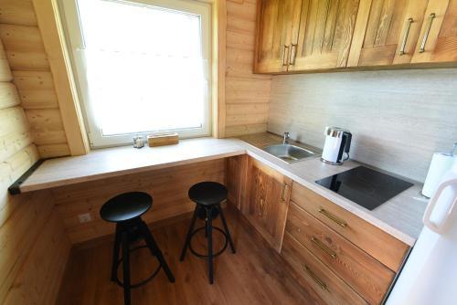 A kitchen or kitchenette at Kalniaus-Sodyba
