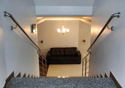 A seating area at Hotel Palmeiras Ltda
