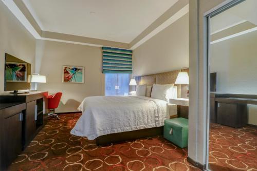A bed or beds in a room at Hampton Inn Tropicana Las Vegas