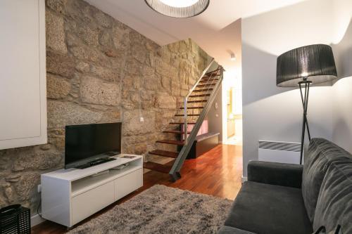 Een TV en/of entertainmentcenter bij Stay In Apartments