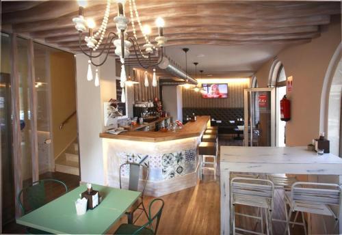 The lounge or bar area at Habitat Cm Muxia