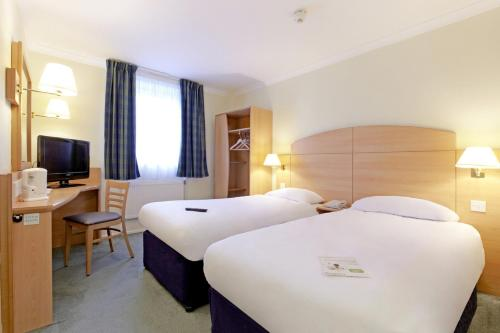 A bed or beds in a room at Campanile Hotel Leicester