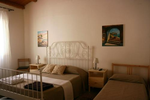 A bed or beds in a room at B&B Il Carmine Augusta