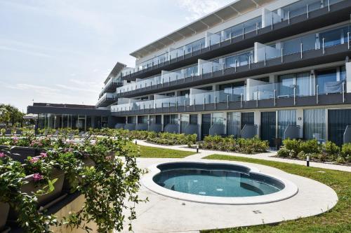 The swimming pool at or near Laguna Palace Resort