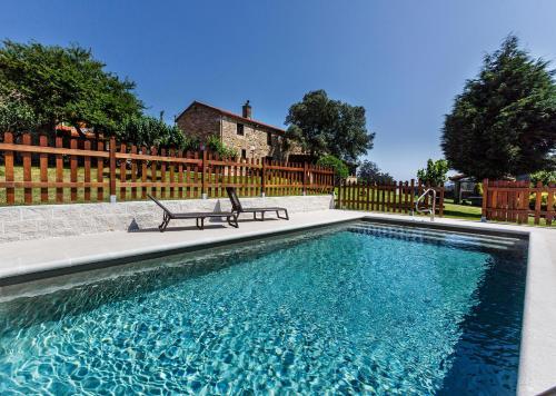 The swimming pool at or near Casa Castiñeira
