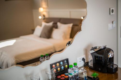 A bed or beds in a room at Boutique Hotel Promenade
