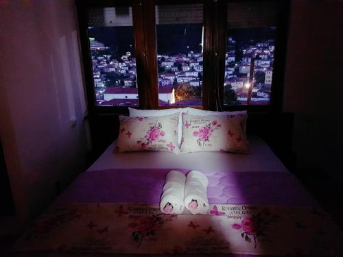 A bed or beds in a room at On Top Apartments
