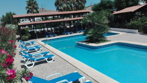 The swimming pool at or near Hotel La Carreta